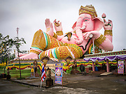 "29 SEPTEMBER 2012 - NAKORN NAYOK, THAILAND:  A statue of Ganesh at Wat Utthayan Ganesh, a temple dedicated to Ganesh in Nakorn Nayok, about three hours from Bangkok. Ganesha Chaturthi also known as Vinayaka Chaturthi, is the Hindu festival celebrated on the day of the re-birth of Lord Ganesha, the son of Shiva and Parvati. The festival, also known as Ganeshotsav (""festival of Ganesha"") is observed in the Hindu calendar month of Bhaadrapada, starting on the the fourth day of the waxing moon. The festival lasts for 10 days, ending on the fourteenth day of the waxing moon. Outside India, it is celebrated widely in Nepal and by Hindus in the United States, Canada, Mauritius, Singapore, Thailand, Cambodia, Burma , Fiji and Trinidad & Tobago.     PHOTO BY JACK KURTZ"