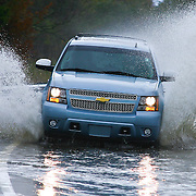 10/30/12 - Smyrna, DE - Hurricane Sandy - Motorist driving a 2012 Chevrolet Tahoe drives though flooded woodland beach road Tuesday, Oct. 30, 2012, in Smyrna DE.<br />