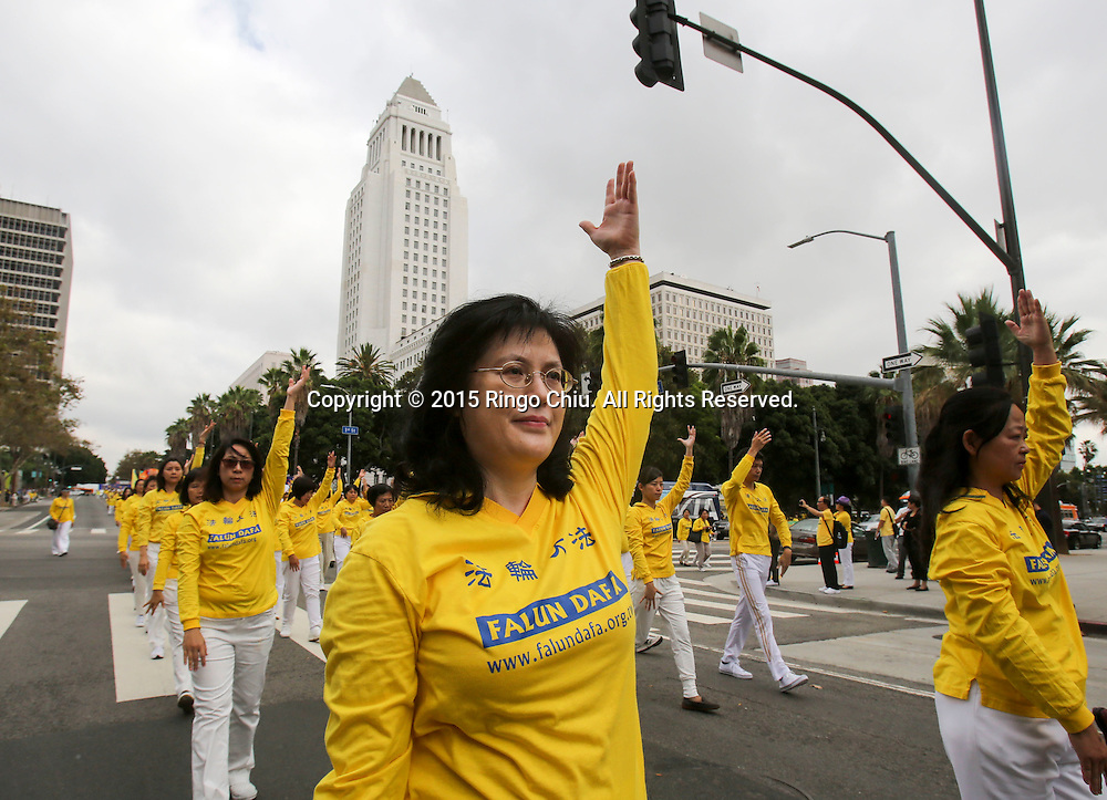 Thousands Falun Gong practitioners march to show their support for the global lawsuit action against Chinas former President Jiang Zemin (1993-2003), who is being sued for crimes including genocide and torture, October 15, 2015 in Los Angeles, California.(Photo by Ringo Chiu/PHOTOFORMULA.com)