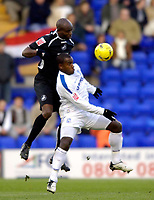 Photo: Jed Wee.<br />Tranmere Rovers v Swansea City. Coca Cola League 1.<br />26/11/2005.<br />Swansea's Ezomo Iriekpen (L) jumps high to head the ball away from Tranmere's Delroy Facey.