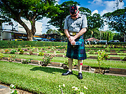 "11 NOVEMBER 2018 - KANCHANABURI, KANCHANABURI, THAILAND: STEWART WILSON, a Scottish veteran of the British army, pauses at the grave of a Scottish soldier killed on the ""Death Railway"" during the Rememberance Day ceremony at the Kanchanaburi War Cemetery in Kanchanaburi, Thailand. Kanchanaburi is the location of the infamous ""Bridge On the River Kwai"" and was known for the ""Death Railway"" built by Japan during World War II using allied, principally British, Australian and Dutch, prisoners of war as slave labor. There are 6,982 people buried in the cemetery, including 5,000 Commonwealth soldiers and 1,800 Dutch soldiers. November 11, 2018 marked the 100th anniversary of the end of World War I, celebrated as Rememberance Day in the UK and the Commonwealth and Veterans' Day in the US.   PHOTO BY JACK KURTZ"