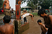 As a way to beat the oppressive Pakistani heat the muddy, sewage filled canals in Islamabad become a summertime swimming hole, as lower-class boys of all ages jump from a bridge into the water.