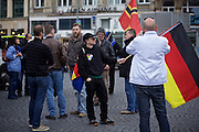 Frankfurt am Main   11 Apr 2015<br /> <br /> Am Samstag (11.04.2015) demonstrierten etwa 35 Personen der Gruppe &quot;Freie B&uuml;rger f&uuml;r Deutschland&quot; (FBfD, ex PEGIDA) auf dem Rossmarkt in Frankfurt am Main gegen &quot;Islamisierung&quot;, ihre Redebeitr&auml;ge gingen in dem Geschrei der etwa 800 Gegendemonstranten unter.<br /> Hier: FBfD-Aktivisten bei der Kundgebung.<br /> <br /> &copy;peter-juelich.com<br /> <br /> [Foto honorarpflichtig   No Model Release   No Property Release]