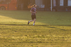 © Licensed to London News Pictures. 29/11/2019. London, UK. A man jogs on Blackheath on a cold and crisp November morning. Temperatures will continue to drop this evening with lows of 1°.   Photo credit: George Cracknell Wright/LNP