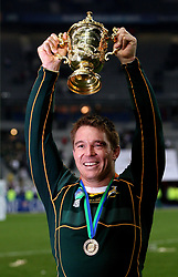 South Africa's John Smit holds aloft the trophy following victory in the IRB Rugby World Cup Final match at Stade de France, Saint Denis, France.