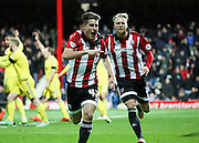 Brentford midfielder Sergi Canos scoring the first goal of the game to take the score 1-0 during the Sky Bet Championship match between Brentford and Nottingham Forest at Griffin Park, London, England on 21 November 2015. Photo by Matthew Redman.