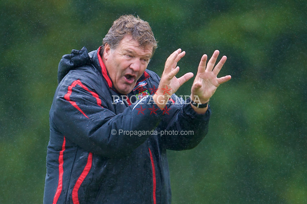 CARDIFF, WALES - Tuesday, August 19, 2008: Wales' manager John Toshack watches his players training in the rain at the Vale of Glamorgan Hotel ahead of their international friendly match against Georgia. (Photo by David Rawcliffe/Propaganda)