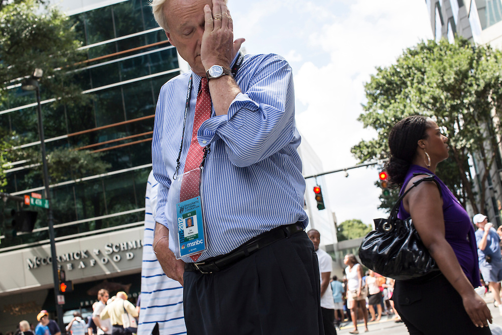 MSNBC host Chris Matthews stops to wipe his face at Carolinafest, a public street festival held ahead of the Democratic National Convention, on Monday, September 3, 2012 in Charlotte, NC.