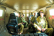 Israel, West Bank, Israeli reserve soldiers on patrol during active duty. Interior of the armoured jeep