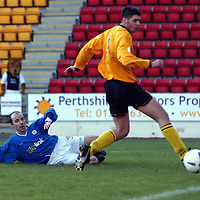 St Johnstone v Raith Rovers...24.01.04<br />Raith's Ian Brown can't prevent Brian McLaughlin from scoring St Johnstone's second goal<br /><br />Picture by Graeme Hart.<br />Copyright Perthshire Picture Agency<br />Tel: 01738 623350  Mobile: 07990 594431