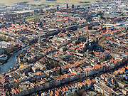 Nederland, Zuid-Holland, Gouda, 20-02-2012; zuidwestelijk gedeelte van de binnenstad met Gouwekerk en aan het water van de Gouwe de korenmolen De Roode Leeuw (stadsmolen)..Gouda is bekend van de goudse kaas, kaarsen, pijpen en stroopwafels.The old town of  Gouda, with church and  mill. Gouda is famous for its cheese, candles, pipes and caramel waffles..luchtfoto (toeslag), aerial photo (additional fee required) .copyright foto/photo Siebe Swart