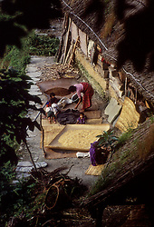 POKHARA, NEPAL - OCTOBER 1992 - A family makes their primitive home near Pokhara in the foothills of the Annapurna mountain range. (PHOTO © JOCK FISTICK)