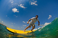 SUP (Stand Up Paddle-board) surfer, Stav Cnaani, enjoys the hot meditarrenean water of June at the beach of Israel