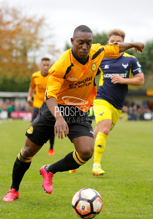 Merstham Midfielder Alex Addai during the FA Cup match between Merstham and Oxford United at Moatside, Merstham, United Kingdom on 5 November 2016. Photo by Andy Walter.