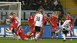 FRANKFURT, GERMANY - Wednesday, November 21, 2007: Wales players block a shot from Germany's Lukas Podolski during the final UEFA Euro 2008 Qualifying Group D match at the Commerzbank Arena. (Pic by David Rawcliffe/Propaganda)