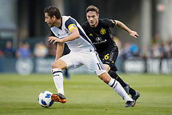 May 9, 2018 - Columbus, OH, U.S. - COLUMBUS, OH - MAY 09: Columbus Crew midfielder Luis Argudo (26) pursues Philadelphia Union midfielder Alejandro Bedoya (11) in the MLS regular season game between the Columbus Crew SC and the Philadelphia Union on May 09, 2018 at Mapfre Stadium in Columbus, OH. (Photo by Adam Lacy/Icon Sportswire) (Credit Image: © Adam Lacy/Icon SMI via ZUMA Press)