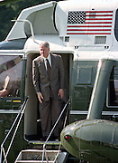 US President Bill Clinton boards Marine One helicopter as he departs for the Governors Conference in Vermont on the South Lawn of the White House July 31, 1995 in Washington, DC.
