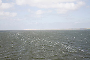 Marsdiep channel looking to sandy beaches and dunes, Texel, Netherlands,