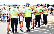Police and grid girls at the A1 GP Feature Race, Taupo, New Zealand, Sunday 25 January 2009. Photo: Andrew Cornaga/PHOTOSPORT