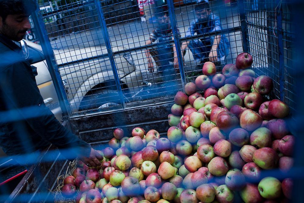 Apples from Kashmir are loaded ina  cart in Srinagar,  September 2011, Kashmir, India. Photographer: Prashanth Vishwanathan