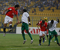 Photo: Steve Bond/Richard Lane Photography.<br />Egypt v Zambia. Africa Cup of Nations. 30/01/2008. Emad Motaeb (L) gets a powerful header in on goal