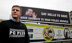 © Licensed to London News Pictures. 05/10/2012.ICC, Birmingham. Preparations are underway to welcome the Conservative Party Conference to Birmingham. The Police Federation have installed a huge poster opposite the Conference venue. Pictured, left , Chris Jones (West Mids Force). Photo credit : Dave Warren/LNP