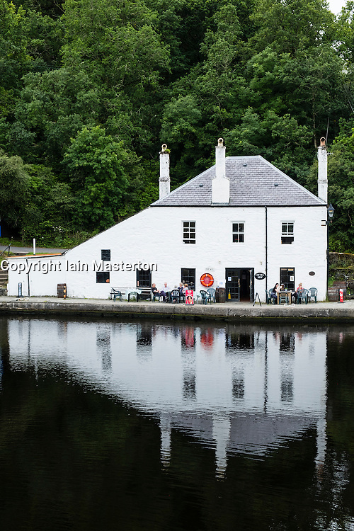 Cafe reflected beside basin on Crinan Canal in Argyll and Bute in Scotland, United Kingdom