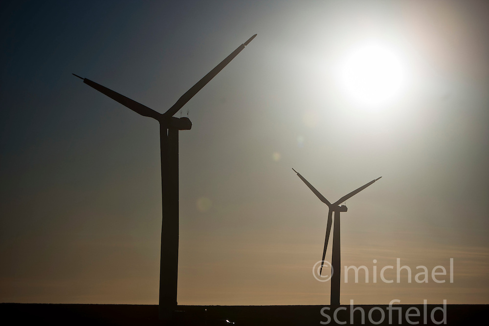 Wind turbines in the process of being built, seen in the sunlight at the Drone Hill Wind Farm North...