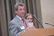 18174Sales Celebration and Awards Ceremony, April 19, 2007. Walter Hall Rotunda...Tom Starr presents the Starr Award to Erin Cochran