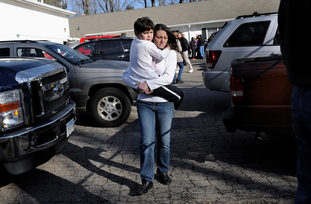 A woman is reunited with boy from Sandy Hook School at a firehouse staging area near the school.