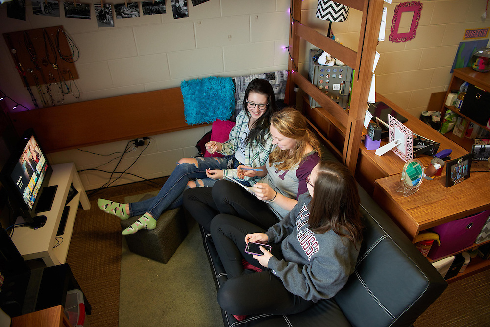 Activity; Smiling; Socializing; Studying; Talking; Buildings; Eagle Hall; Dorm; Location; Inside; Objects; Bed; Couch; Computer; Books; notepad; Phone Cell Smartphone iPhone; People; Student Students; Woman Women; Type of Photography; Candid; Group; UWL UW-L UW-La Crosse University of Wisconsin-La Crosse; Winter; February