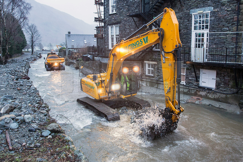 © Licensed to London News Pictures. 31/12/2015. Glenridding UK. The residents of Glenridding are having to dredge the beck that flooded the village 3 times again this morning to prevent further flooding after heavy rain fall yesterday caused tons of rocks to flow down stream. Photo credit: Andrew McCaren/LNP