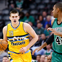 10 March 2017: Denver Nuggets forward Nikola Jokic (15) brings the ball up court against Boston Celtics center Al Horford (42) during the Denver Nuggets 119-99 victory over the Boston Celtics, at the Pepsi Center, Denver, Colorado, USA.