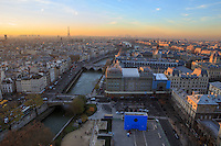 Looking out over the rooftops of Paris, France towards the Eiffel Tower and Les Invalides in the distance from the roof of Notre Dame Cathedral