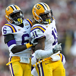 November 6, 2010; Baton Rouge, LA, USA; LSU Tigers linebacker Kelvin Sheppard (11) celebrates with teammate LSU Tigers safety Craig Loston (6) after recovering a fumble during the second half  against the Alabama Crimson Tide at Tiger Stadium. LSU defeated Alabama 24-21.  Mandatory Credit: Derick E. Hingle