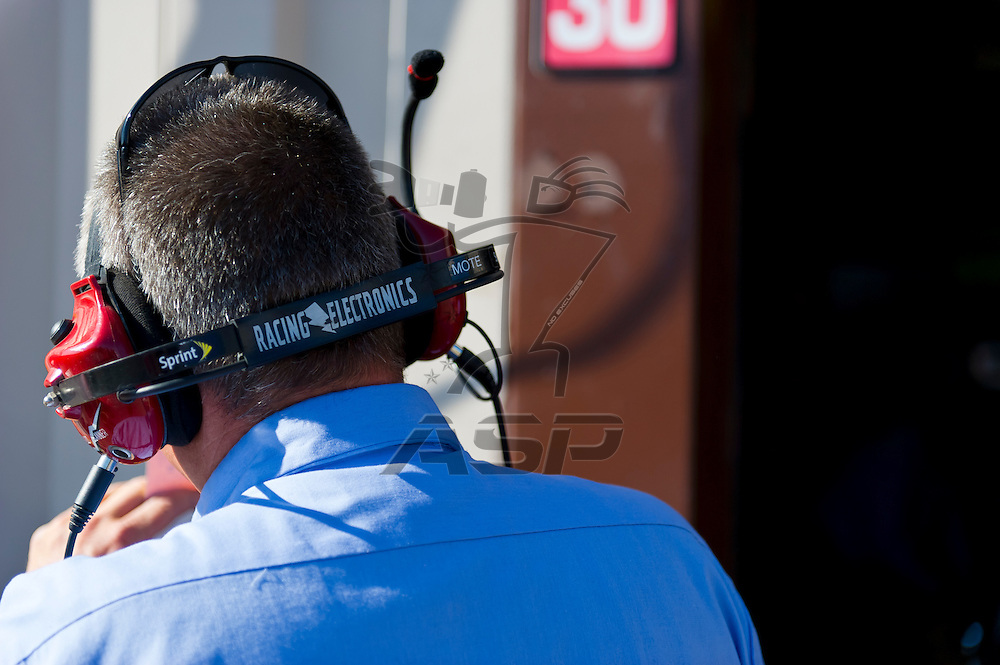 Brooklyn, MI - JUN 14, 2012:  The NASCAR Sprint Cup teams work in the garage during the second test session for the Quicken Loans 400 race at the Michigan International Speedway in Brooklyn, MI.