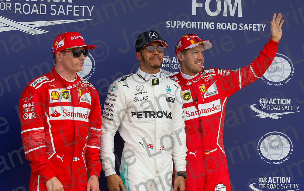 The 2017 Formula 1 Rolex British Grand Prix at Silverstone Circuit, Northamptonshire.<br /> <br /> Pictured: Mercedes AMG Petronas Driver Lewis Hamilton celebrates qualifying in pole position as Ferrari's Kimi Raikkonen and Sebastian Vettel place second and third on the grid at the British F1 Grand Prix.<br /> <br /> Jamie Lorriman<br /> mail@jamielorriman.co.uk<br /> www.jamielorriman.co.uk<br /> +44 7718 900288