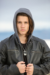 man with long hair in a hoody leather jacket