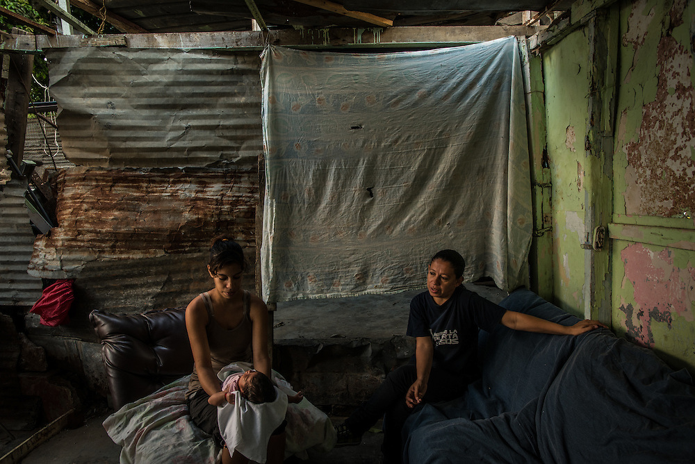 CARACAS, VENEZUELA - MARCH 20, 2016: The afternoon her water broke, 19-year old Yanny Trejo (left) did not rush to the hospital, but stayed at her sweltering shack home in a slum high on a hill overlooking Caracas until she knew she was nearly ready to give birth. Then she climbed the steep stairs out of the slum and made the 30-minute trip to the state-run Concepci&oacute;n Palacios maternity hospital.  Friends who had recently given birth advised her not to arrive too early. &ldquo;You have to arrive when your baby is just about to crown&hellip;if not, they will send you away to another hospital, then that hospital will send you to another, and it just keeps going&rdquo; Trejo told IRIN.  Doctors at the hospital admit they are working with limited resources and frequently have to turn away women in labour. &ldquo;The reality is that we only have the capacity to accept patients in the moment when they are about to deliver,&rdquo; said one of the doctors, Moraima Hern&aacute;ndez. &ldquo;Patients have to play roulette with various hospitals to receive medical attention.&rdquo;<br />  PHOTO: Meridith Kohut for IRIN News