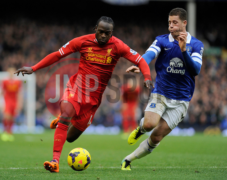 Liverpool's Victor Moses is chased down by Everton's Ross Barkley - Photo mandatory by-line: Dougie Allward/JMP - Tel: Mobile: 07966 386802 23/11/2013 - SPORT - Football - Liverpool - Merseyside derby - Goodison Park - Everton v Liverpool - Barclays Premier League