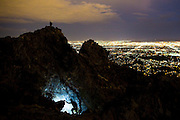 Headlamps illuminate the trail as hikers head down from the summit of Piestewa Peak in the heart of Phoenix on July 28, 2015. The steep, rocky trail ascends 1,500 feet above the city, making it a popular attraction even when temperatures rise well into the hundreds during the summer. As the sun goes down the peak becomes a sanctuary for hikers who prefer to avoid hiking in the heat of the day. (For The New York Times)