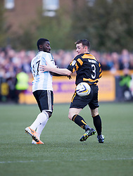 Hearts Prince Buaben and Alloa Athletic's Mark Docherty.<br /> half time : Alloa Athletic 0 v 0 Hearts, Scottish Championship played at Recreation Park, Alloa.