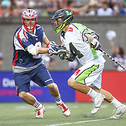 Drew Adams #14 of the New York Lizards runs with the ball during the game at Harvard Stadium on July 19, 2014 in Boston, Massachusetts. (Photo by Elan Kawesch)