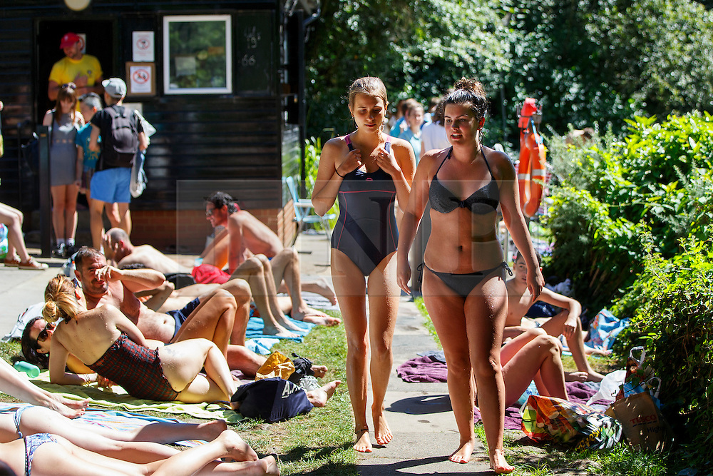 © Licensed to London News Pictures. 12/08/2016. London, UK. People sunbathe and enjoy hot weather at Hampstead Heath Mixed Bathing Pond in north London on Friday, 12 August 2016. Photo credit: Tolga Akmen/LNP