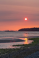 Sunset from East Beach in White Rock, British Columbia, Canada.  Air pollution or smoke from a recent fire in Squamish account for the atmospheric conditions.