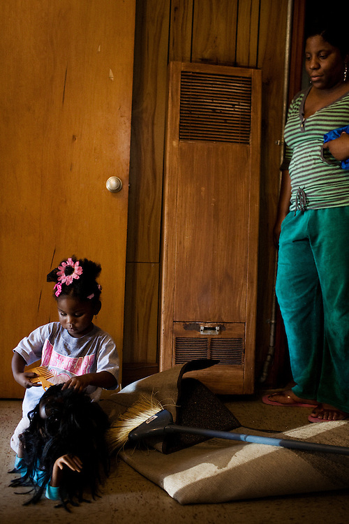 "Gabby, 2, plays with a doll in the apartment she shares with her mother, Lettorea ""Lottie"" Clark, 25, in Albany, GA on Wednesday, October 22, 2008. Lottie and Gabby live off welfare after escaping an abusive relationship with Gabby's father."
