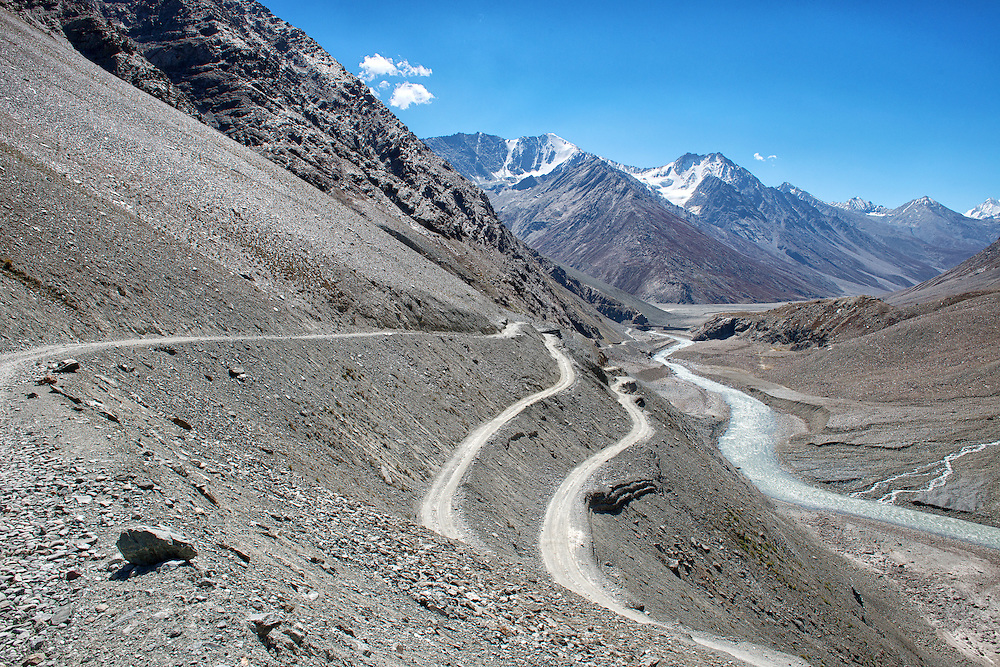 Road from entrance of the Chantratal Lake trekking path to Batal in Himachal Pradesh District of India
