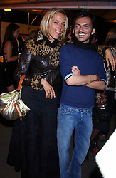 BAY GARNET and MATTHEW WILLIAMSON at an exclusive evening featuring the greatest talents in fashion today in aid of the African children who have been affected bt the AIDS epidemic held at the Chelsea Gardener, Sydney Street, London on 20th September 2004<br />