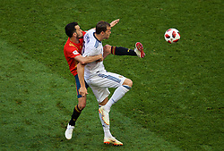 MOSCOW, RUSSIA - Sunday, July 1, 2018: Spain's Sergio Busquets and Russia's Artem Dzyuba during the FIFA World Cup Russia 2018 Round of 16 match between Spain and Russia at the Luzhniki Stadium. (Pic by David Rawcliffe/Propaganda)