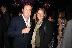 PIERS MORGAN and SARAH BROWN at a party to celebrate the publication of Piers Morgan's book 'Don't You Know Who I Am?' held at Paper, 68 Regent Street, London W1 on 18th April 2007.<br /><br />NON EXCLUSIVE - WORLD RIGHTS